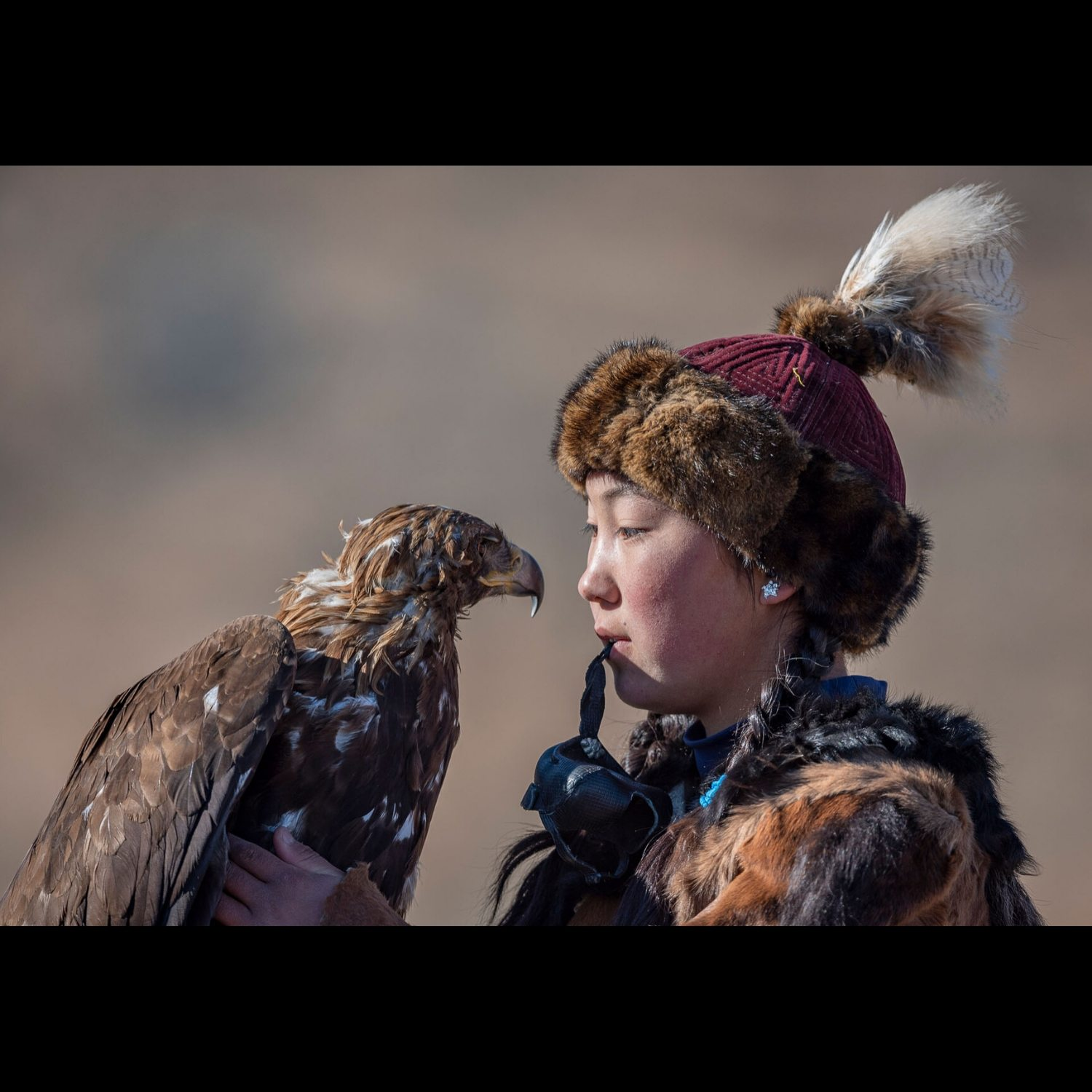 Click through to buy Portrait Photograph Young Eagle Hunter Mongolia photographed by award-winning photographer Ignacio Palacios