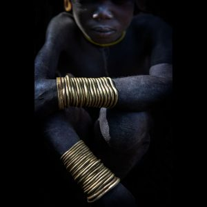 Portrait Photograph of the Mursis tribe photographed of Ethiopia by professional travel photographer Ignacio Palacios