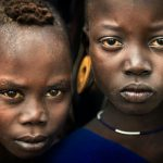 Fine Art Portrait of Young Warriors from Mursi Tribe by professional photographer Ignacio Palacios